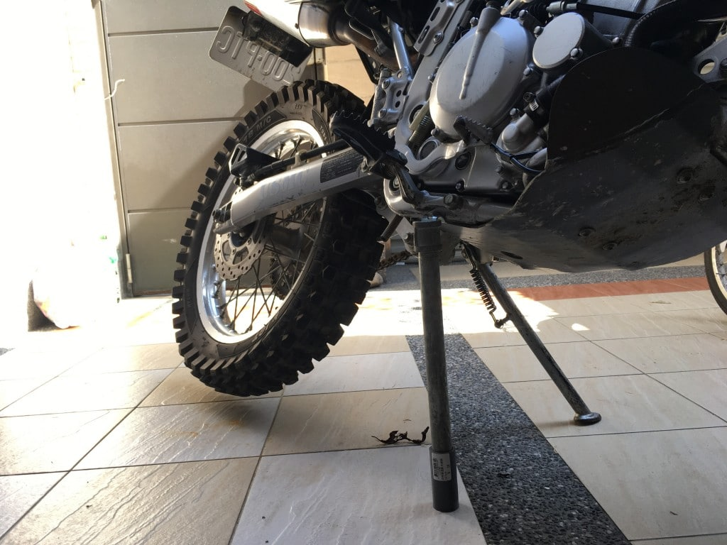 Metal pipe holding up motorcycle