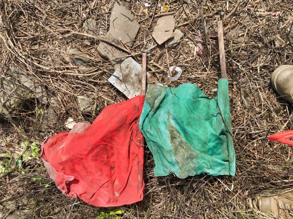 Red and green flags on ground - looks old