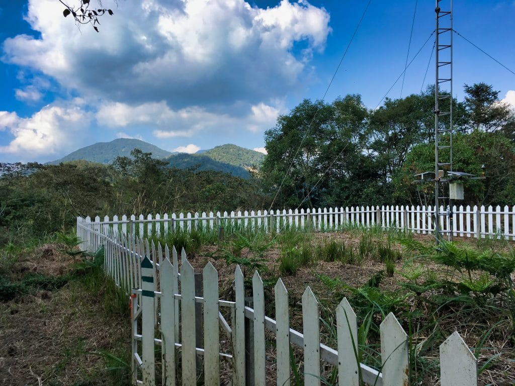 Sunshan Weather Station - 森山氣象站 - surrounded by white picket fence - Mountains and blue skies