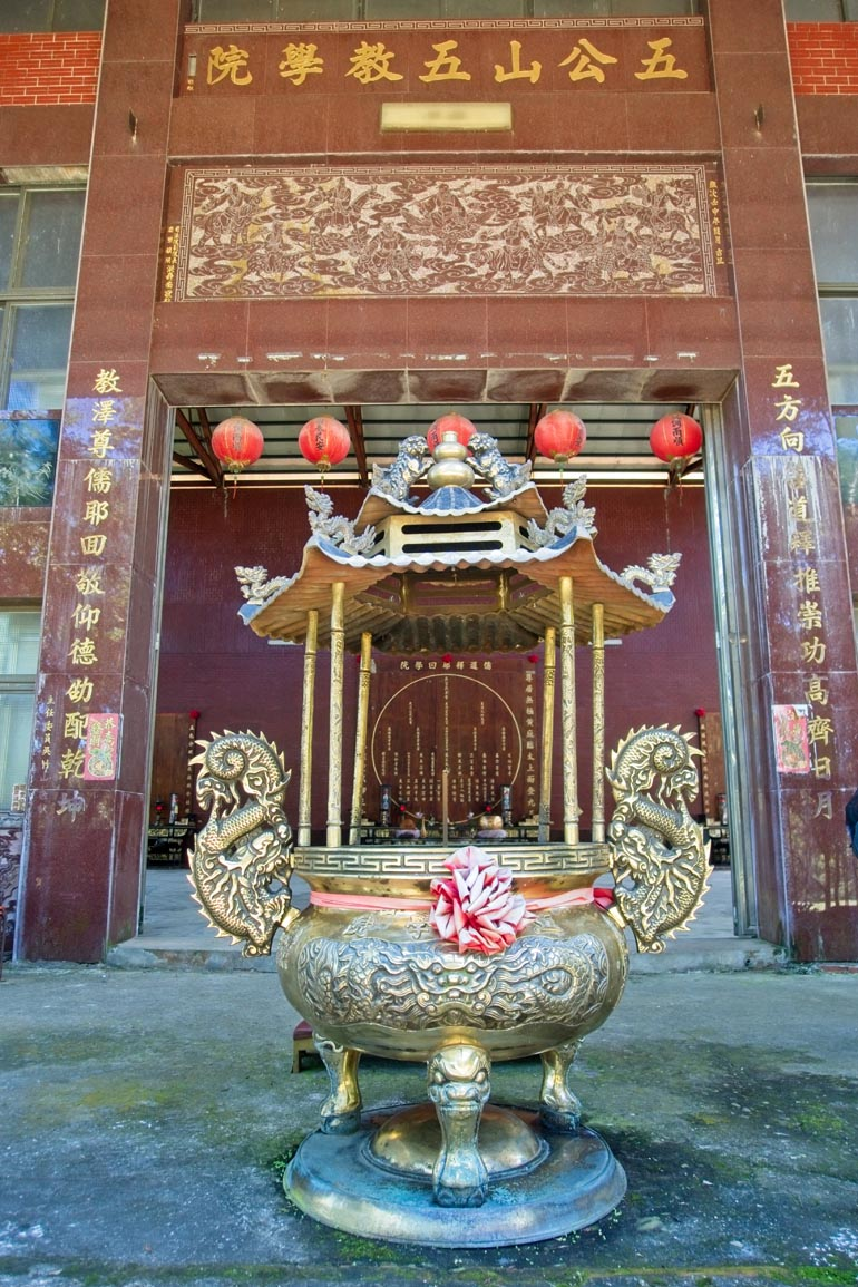 Front of the temple - Large incense burner in front - main doors behind it