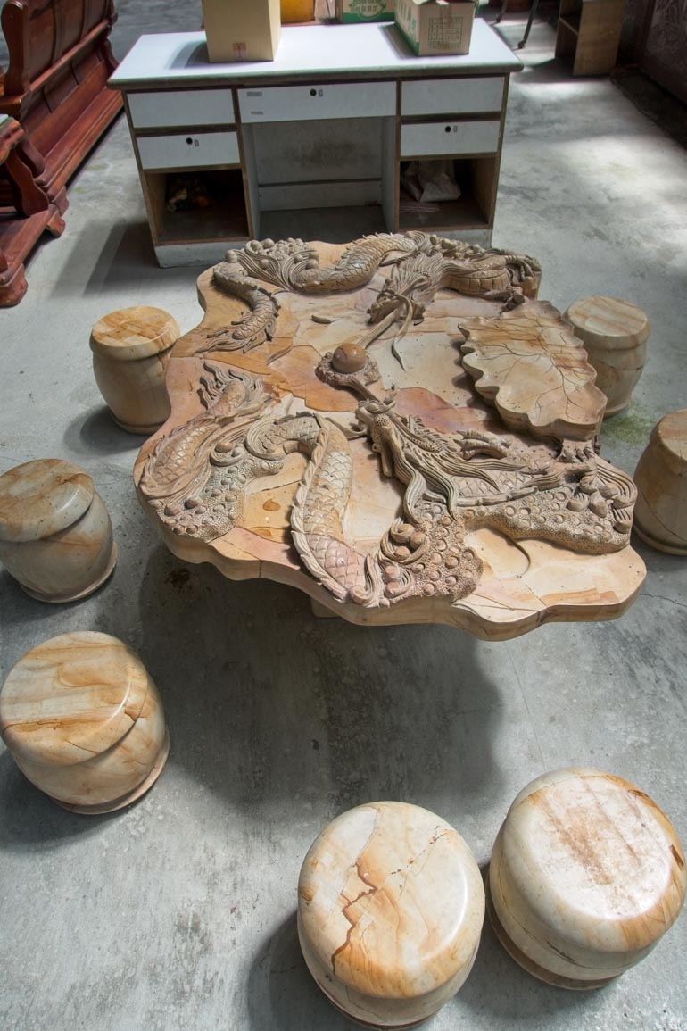 Wood table with Dragons carved into it - Several carved stools around it