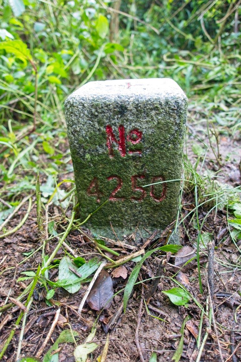 BaShiMoShan 巴士墨山 Triangulation marker - No 4250 written on it in red - closeup