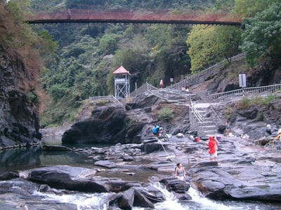 rocky river with footbridge above - ZuMuShan 足母山