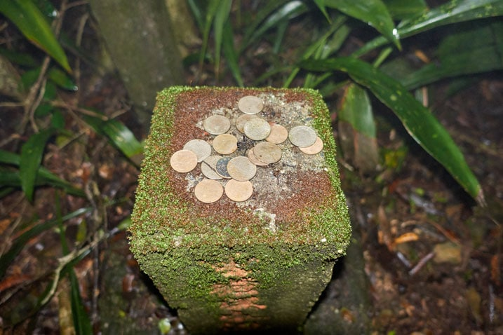 Stone marker with coins on top