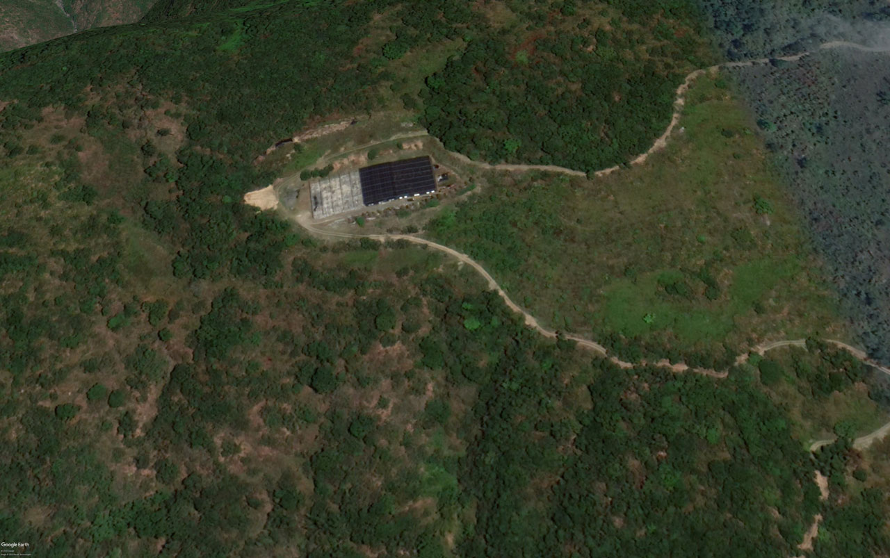 Google Earth image of mountainside - farm and road