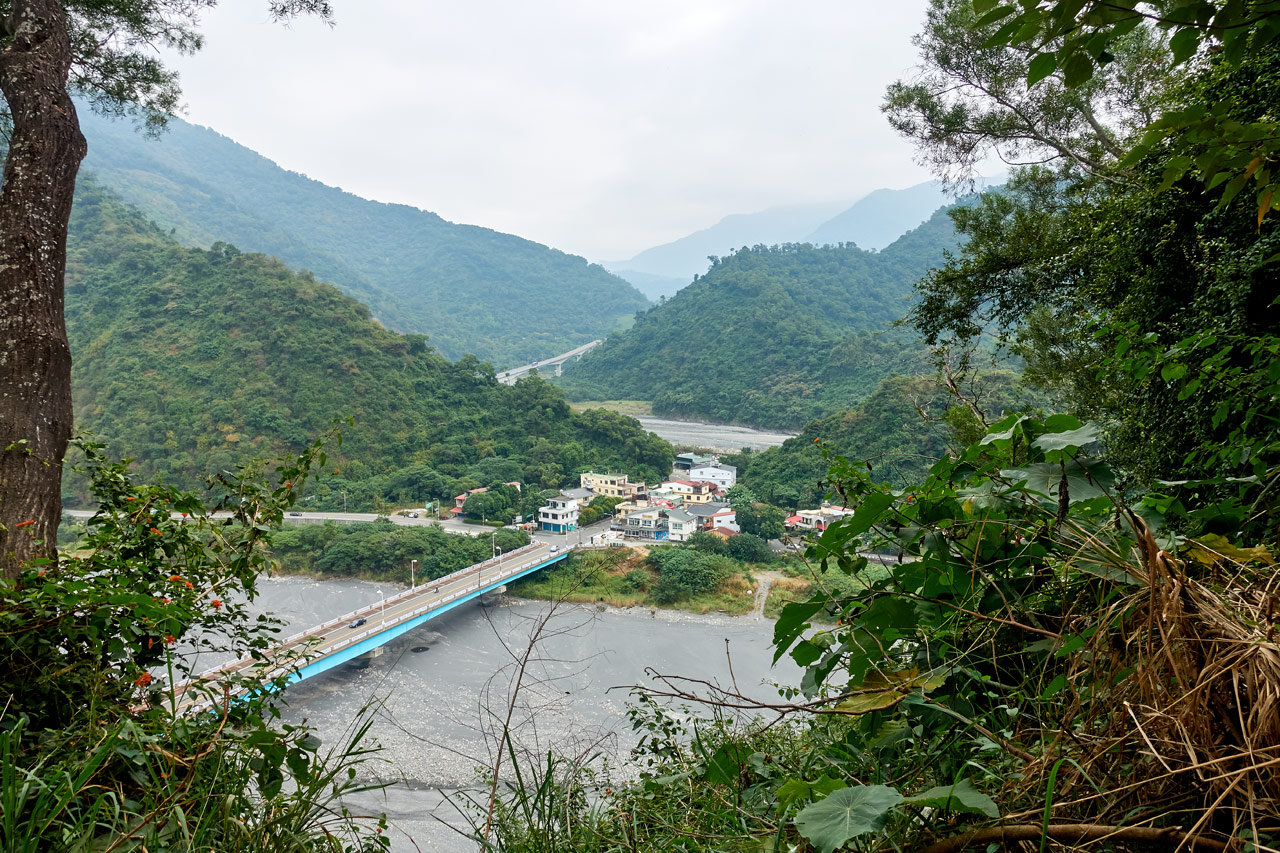 View of the entrance to Maolin - bridge over riverbed - mountains in distance - WeiLiaoShan Hike – 尾寮山