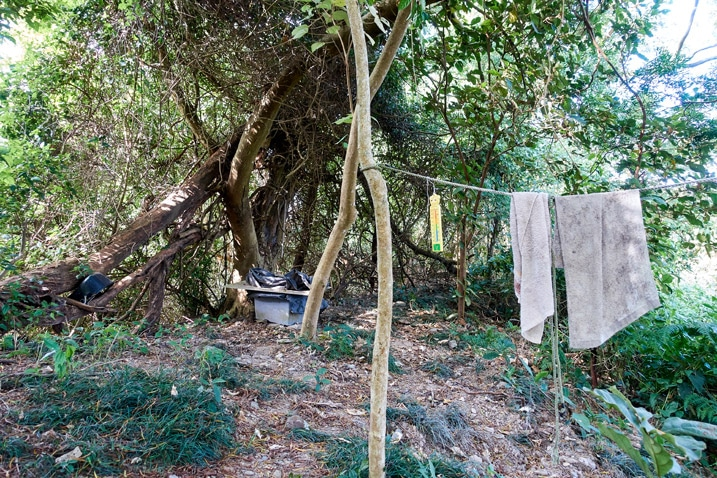 Old table and clothesline with towels hanging - trees in the background - WeiLiaoShan Hike – 尾寮山