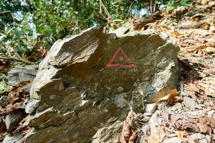 Rock with a triangle painted on it - WeiLiaoShan Hike – 尾寮山