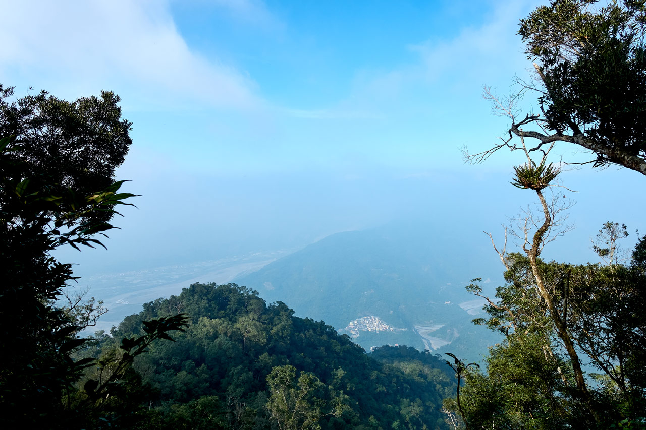 Looking down from a mountain ridge at a village below - WeiLiaoShan 尾寮山 trail