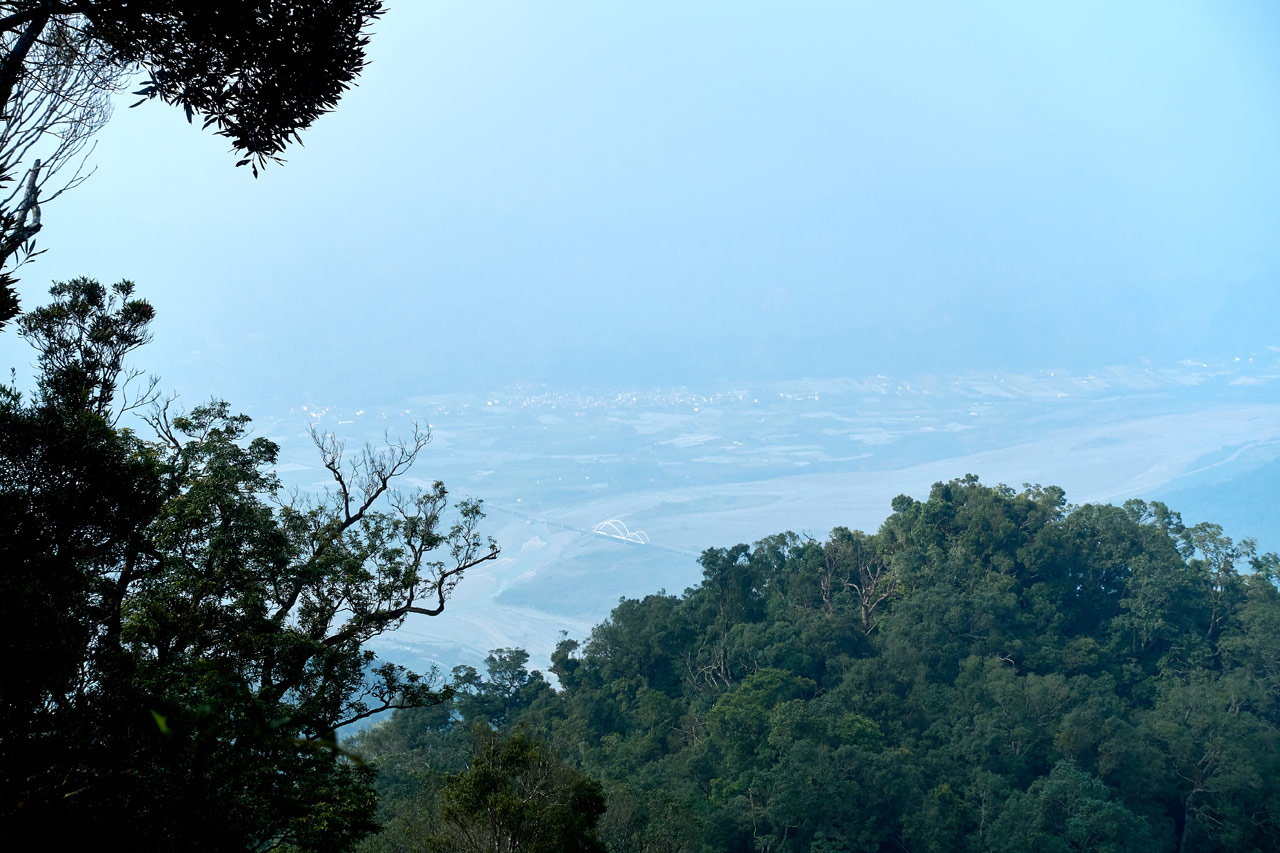 Looking down from a mountain ridge at houses and a river below - WeiLiaoShan 尾寮山 trail