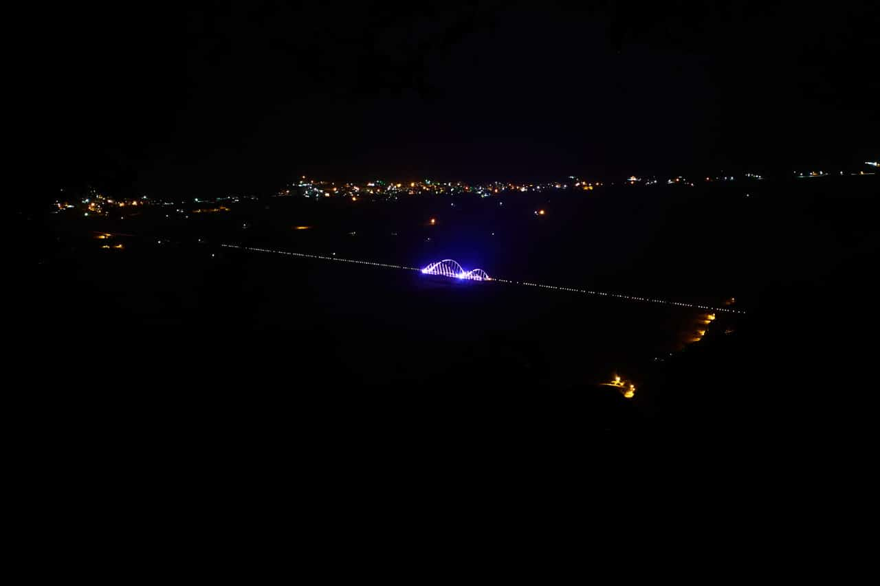 Zoomed in picture of colorful bridge at night - WeiLiaoShan 尾寮山 trail