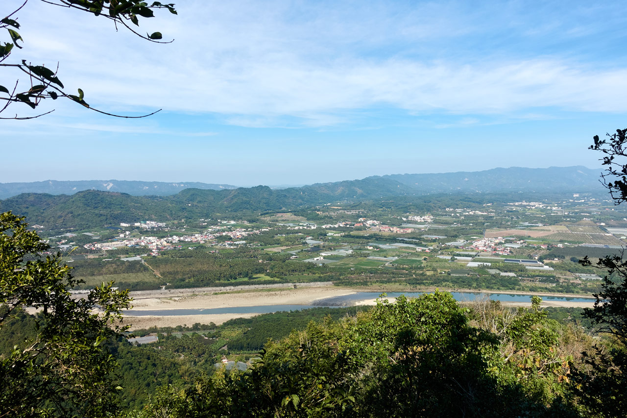 Panoramic of river and farmland with mountains in distance - 旗月縱走