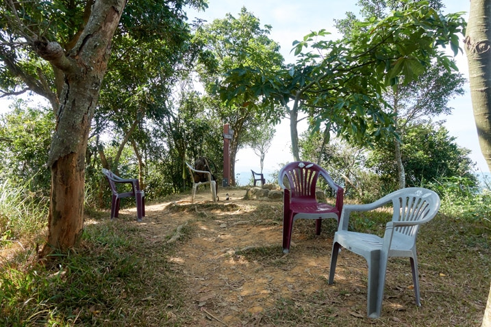 Open area with many plastic chairs and trees - 人頭山 - 旗月縱走