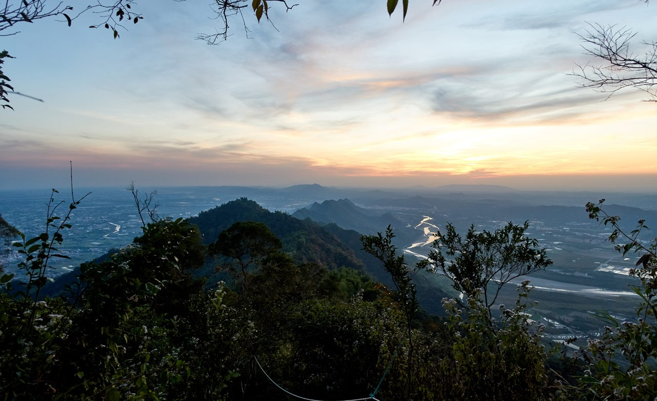 Looking down at mountains and river - near dark - 旗月縱走