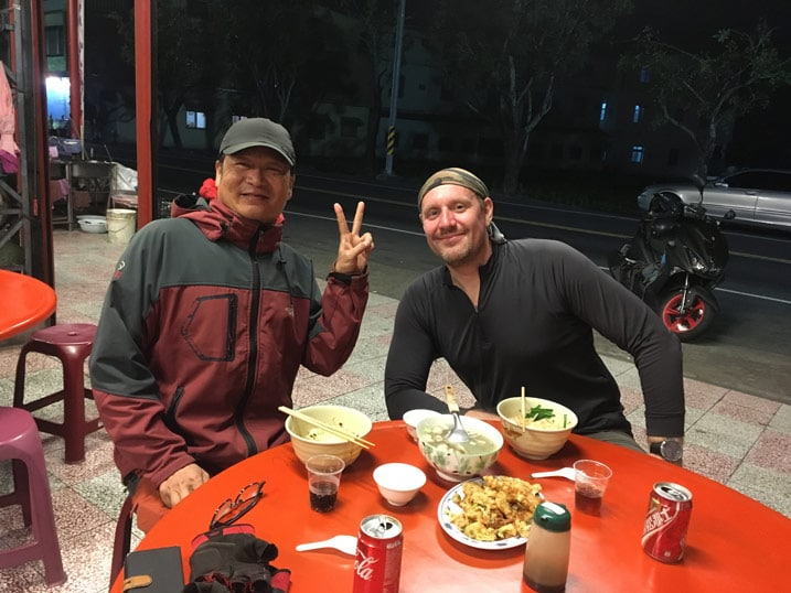 Two men eating dinner at table - 旗月縱走