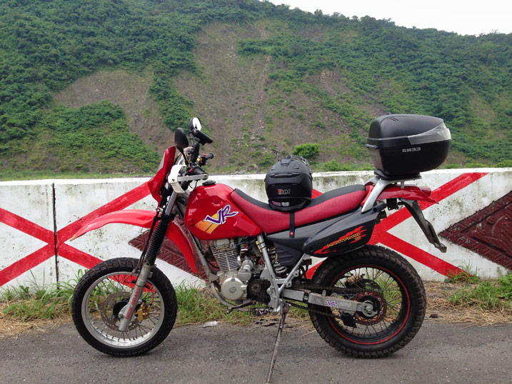 Red Hartford VR Motorcycle with Mountains in background