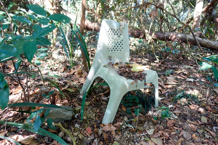 Old broken plastic chair in the forest - XinZhiShan - 新置山 Peak