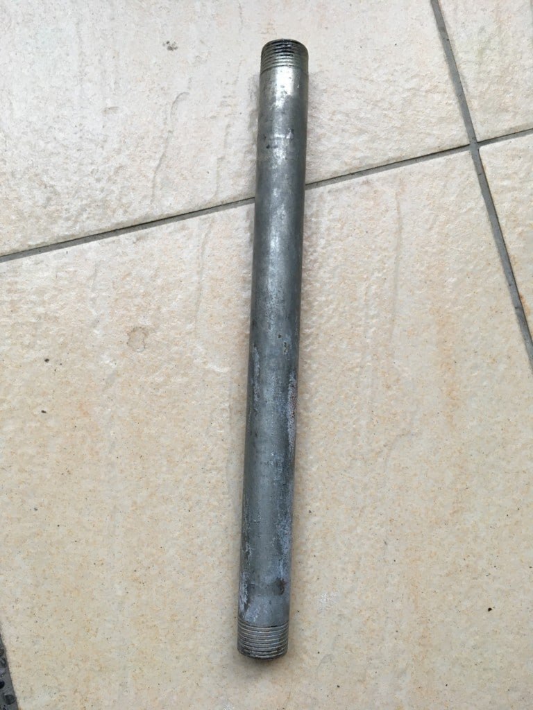 Metal pipe on tile floor