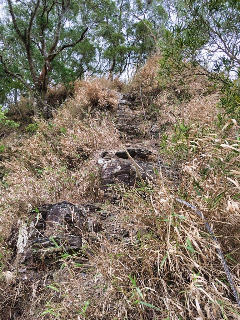 Rocky ridge climb with rope