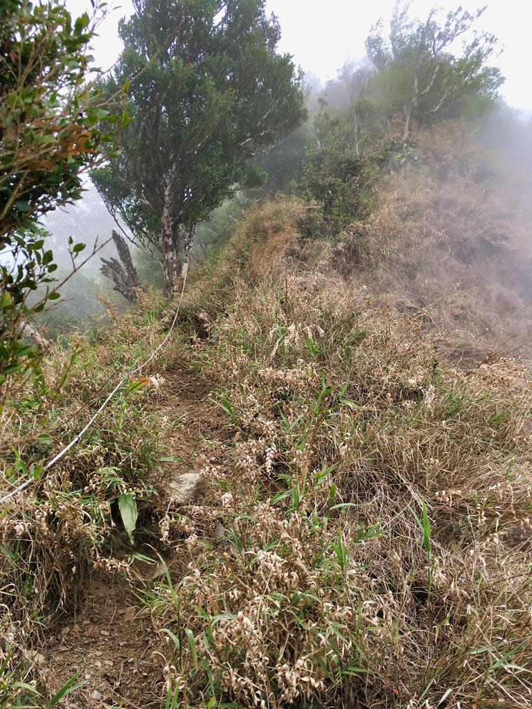 Rope climb, foggy ridge