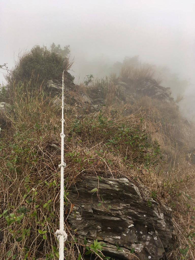 Rocky, foggy ridge with rope
