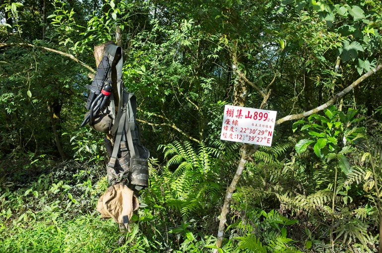 My molle vest hanging from a tree - Pengjishan sign to the right