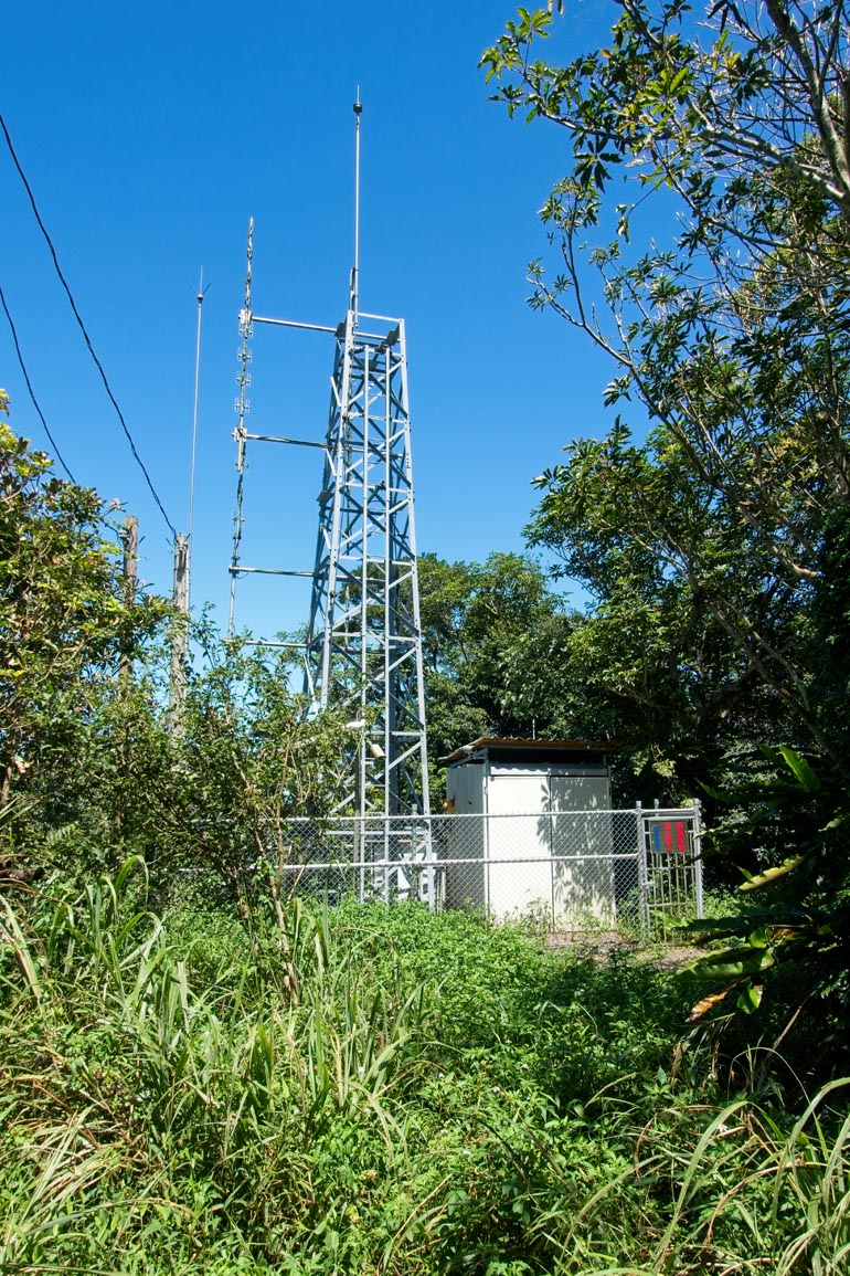 Radio or transmission tower surrounded by a fence