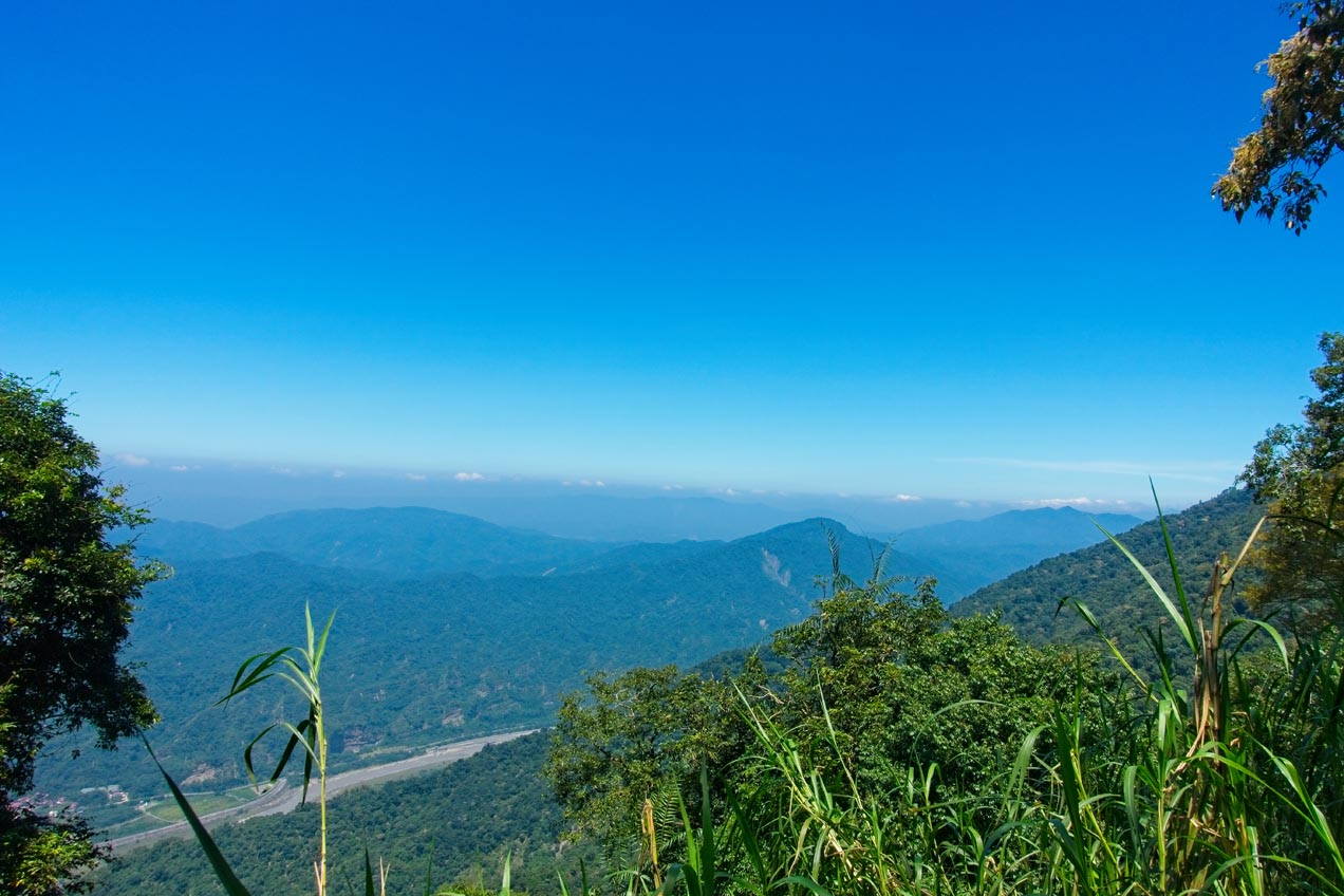 Clear blue skies - mountains and river below