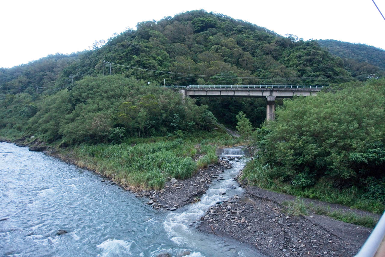 River below - small mountain in background - less light - small bridge from the number 9 with stream underneath