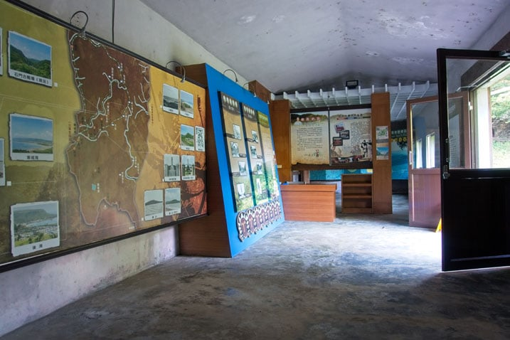 Inside visitor's center - many colorful signs telling you about the area and it's history - desk to the back