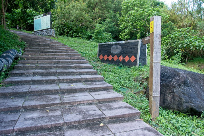 Wide stone steps going up - Sign on left at top - Aboriginal stone art to the right