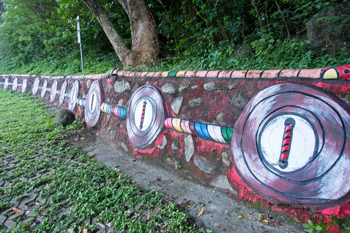 Retaining wall with aboriginal artwork painted on side