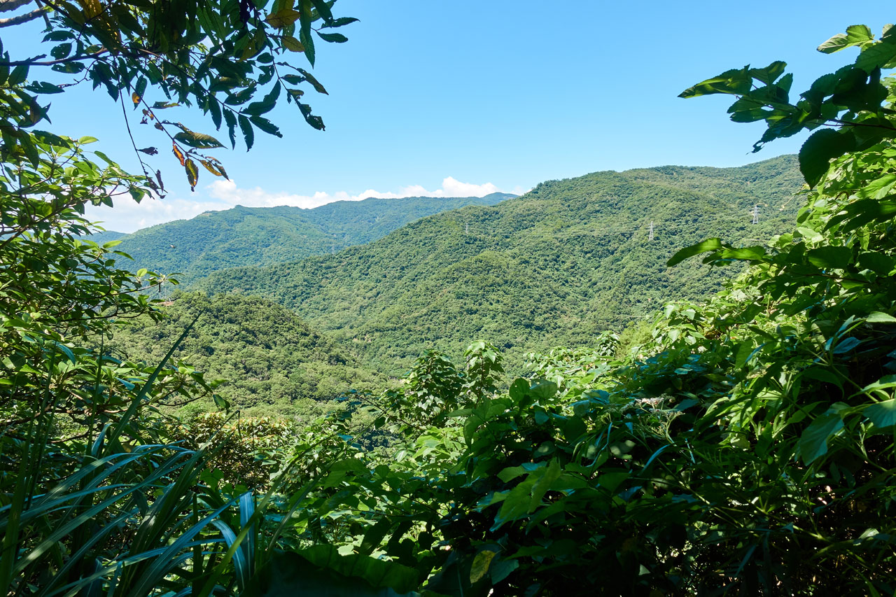 Taiwan mountain landscape - clear blue sky - green mountains below