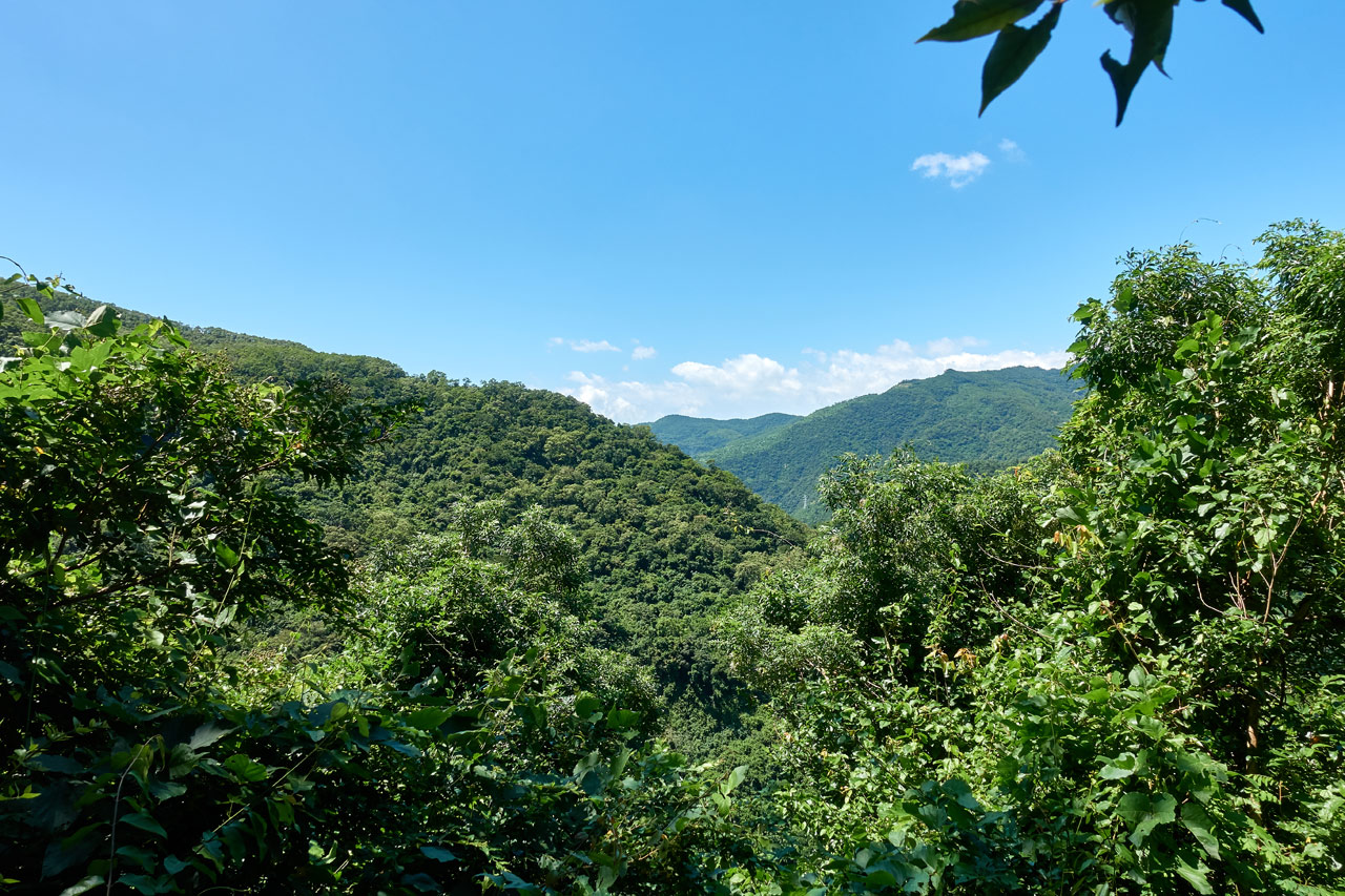 Taiwan mountain landscape - mostly blue sky - green mountains below