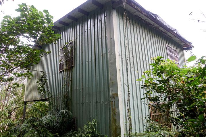 Abandoned green mountain house