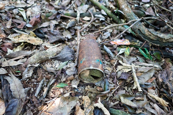 Old rusty can on ground