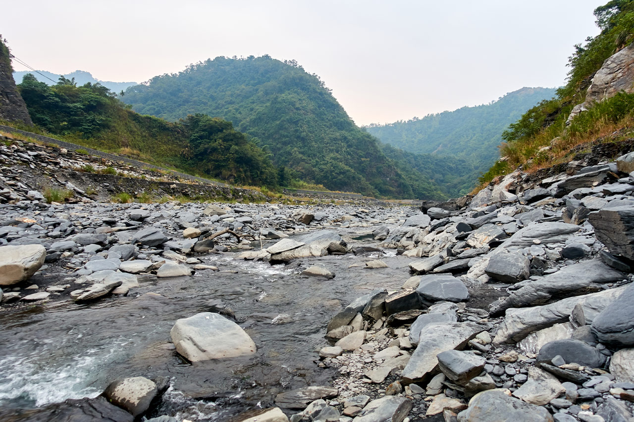 Rocky riverbed - mountains in distance