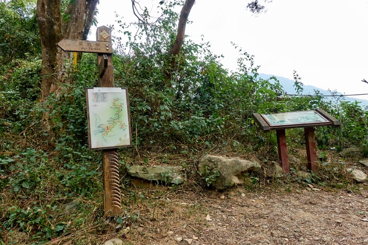 Signs posted on a dirt road - WeiLiaoShan Hike – 尾寮山