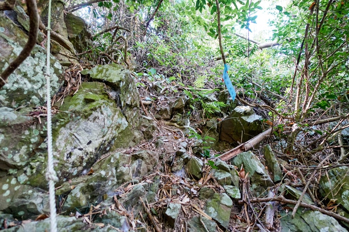 Rope and rocks going up a mountainside - WeiLiaoShan Hike – 尾寮山