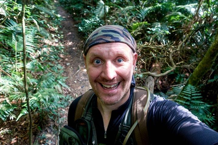 Man standing on trail taking selfie - WeiLiaoShan Hike – 尾寮山