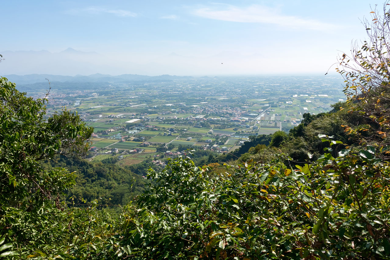Panoramic view of farmland and mountains in distance - 旗月縱走
