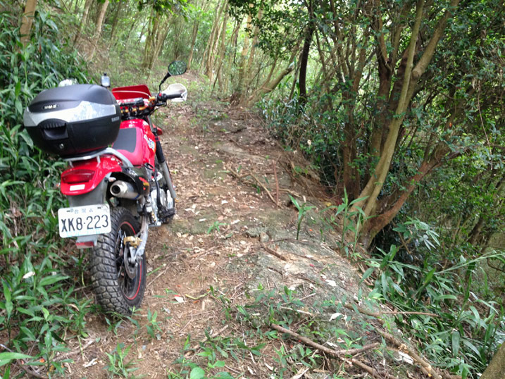 Red Hartford VR Motorcycle on dirt road lined with trees - WuTanShan - 武潭山