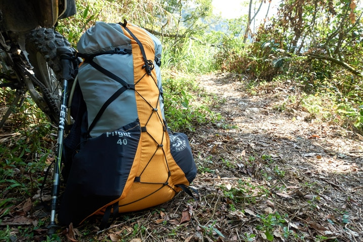 Six Moon Designs Flight 40 Backpack next to motorcycle on trail