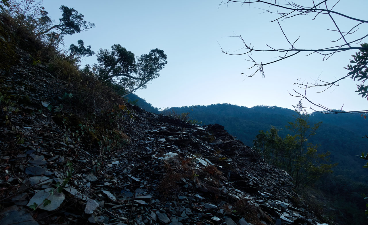 Looking up at landslide on mountainside - early morning