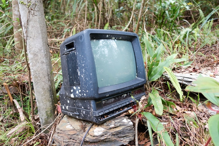 Old TV sitting on rock