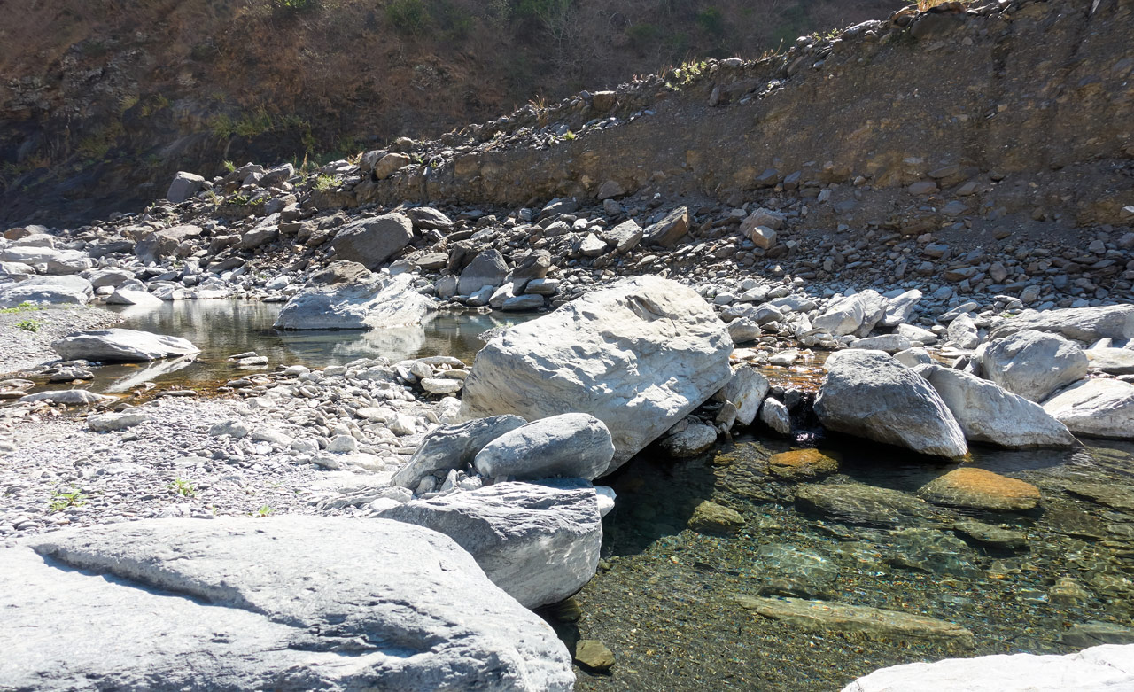 Rocky riverbed with pool of water