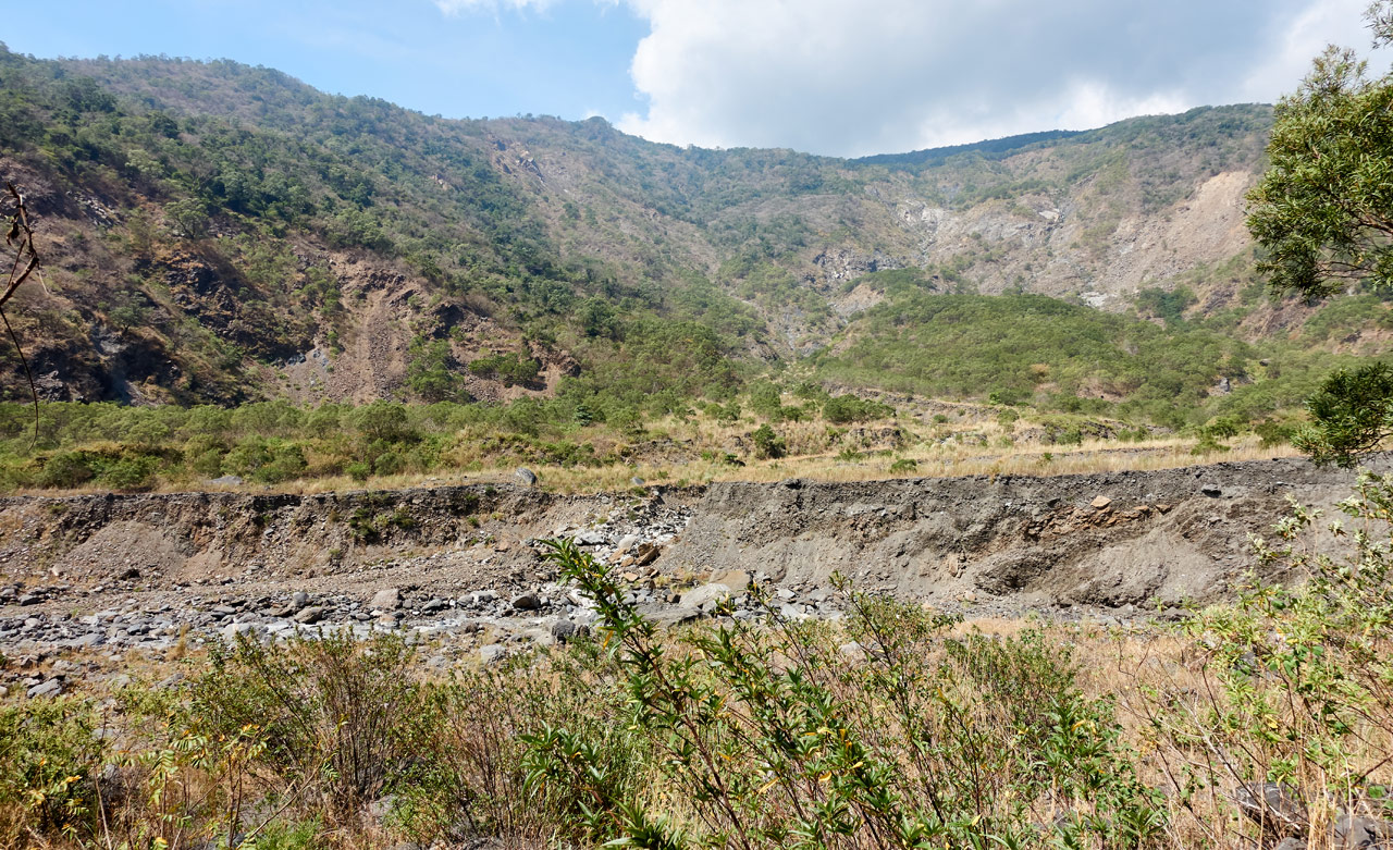 Mountains and rocky riverbed - tall grass in foreground