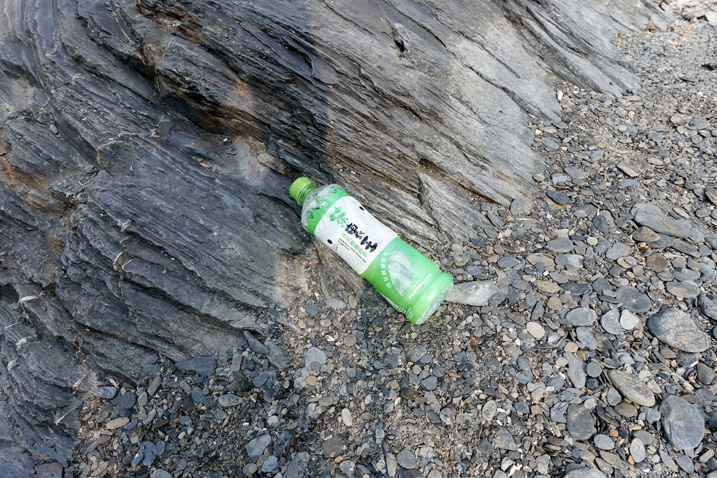 Plastic bottle discarded on riverbed