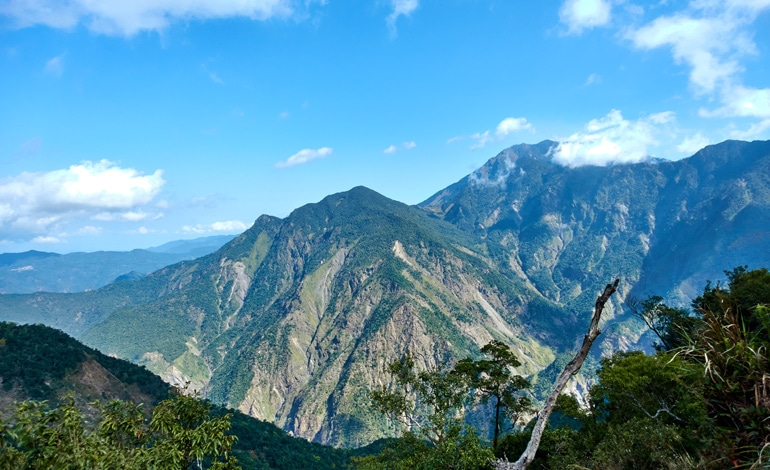 panoramic mountain picture - blue skies and white clouds