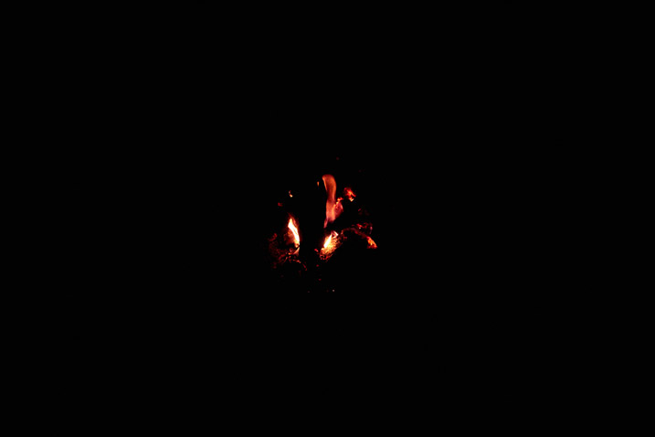 Faint glow of a fire - black all around